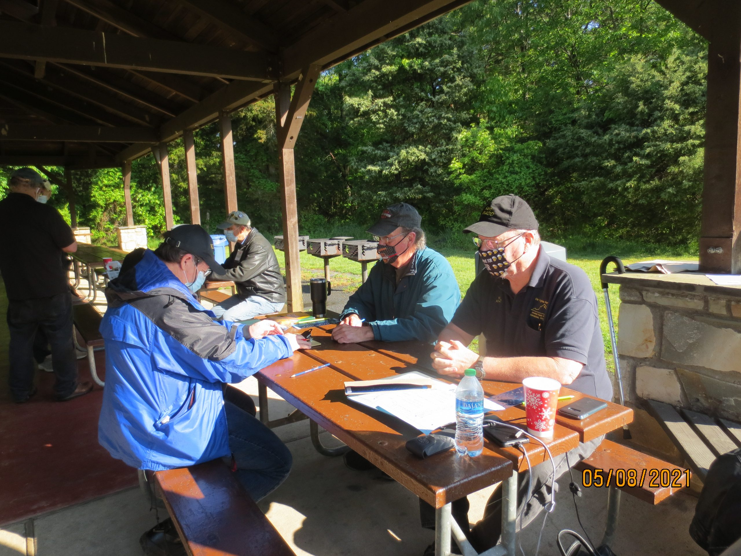 Ray, KM4EKR; George, K4GVT and Ken, KN4DD at test grading table