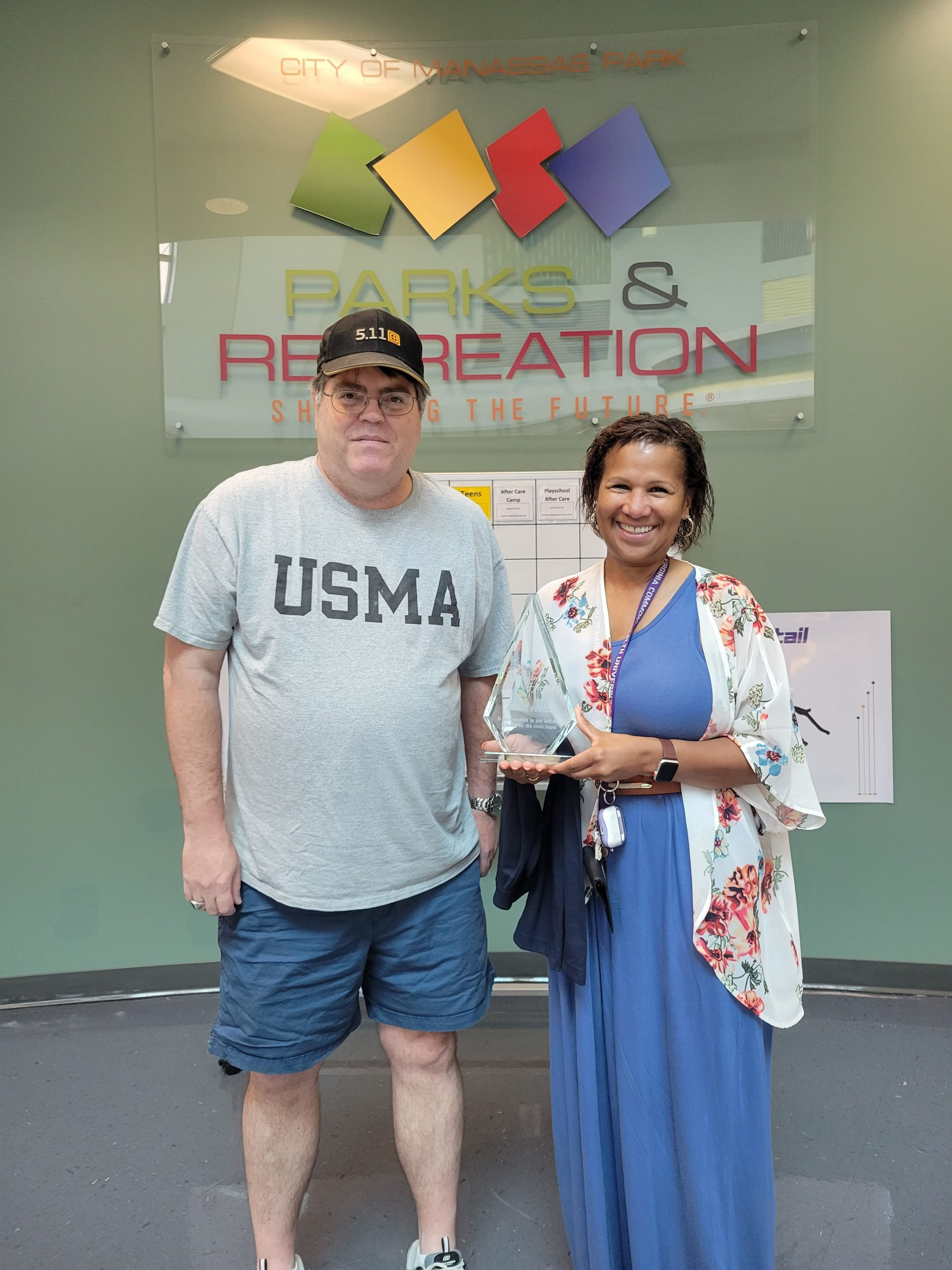 Don WA2SWX presents Award and embroidered polo shirt to Amelia Powell of Parks and Recreation division of Manassas Park