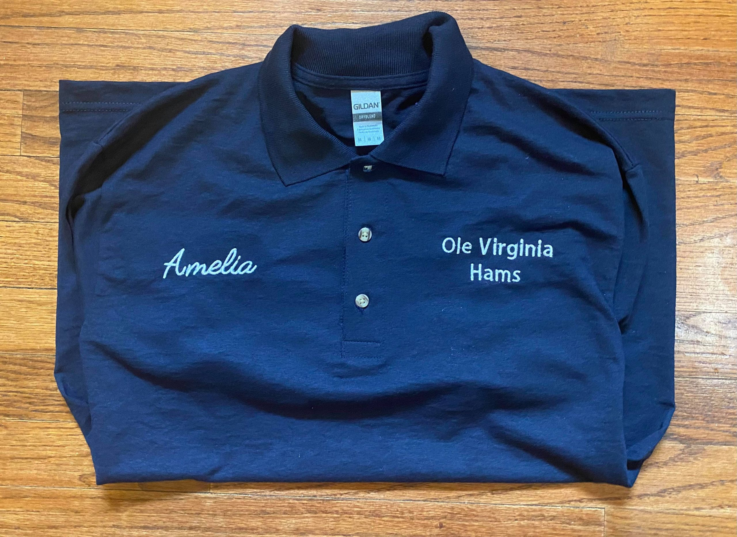 Embroidered polo shirt presented to Amelia Powell of Parks and Recreation division of Manassas Park